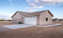 The garage end of new residence built in Hereford Arizona by Isaacson Homes, LLC