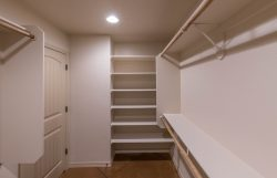 Master closet with shelving and rod and shelf
