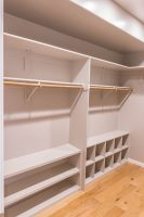 Master walk-in closet with rods, shelves and shoe racks