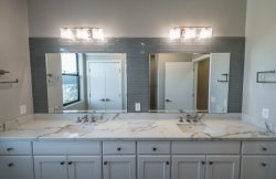 Double sink in Master Bath with double mirrors and lights