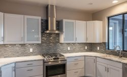 Glass mosaic tile back splash and granite counter top