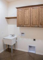 Laundry room with deep utility tub