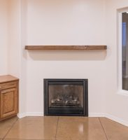 Fireplace inset with real wood mantle