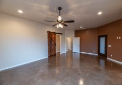 Master bedroom with stained concrete floor