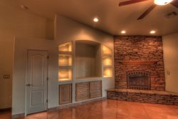 custom built in entertainment center with lighted niches