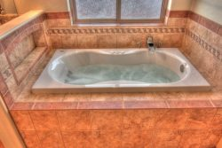 jetted tub with tile surround decor