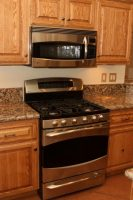 Stainless steel stove and microwave hood fan