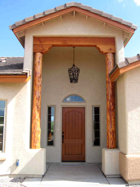 Front doorway of custom home with wood accents.